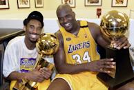 Kobe Bryant and Shaquille O'Neal forged one of the greatest partnerships in NBA history — one that ended in bitterness — but that first championship for the two of them was oh so sweet. They were all smiles in the minutes after disposing of the Indiana Pacers in six games in the 2000 Finals. (AFP/AFP via Getty Images)