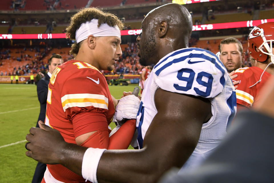 Kansas City Chiefs quarterback Patrick Mahomes, left, and Indianapolis Colts defensive end Justin Houston (99) meet following an NFL football game in Kansas City, Mo., Sunday, Oct. 6, 2019. The Colts won 19-13. (AP Photo/Reed Hoffmann)