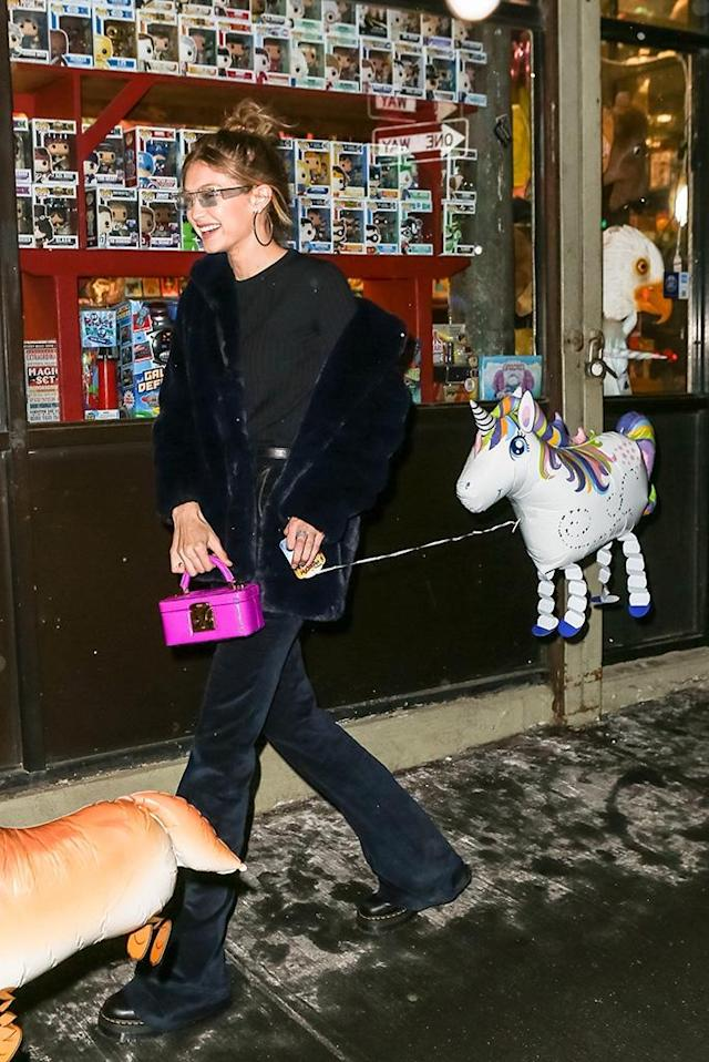 <p>The cold and snow aren't getting her down! Zayn Malik's love headed home to her New York City apartment with a smile and a rainbow unicorn balloon. (Photo: BackGrid) </p>