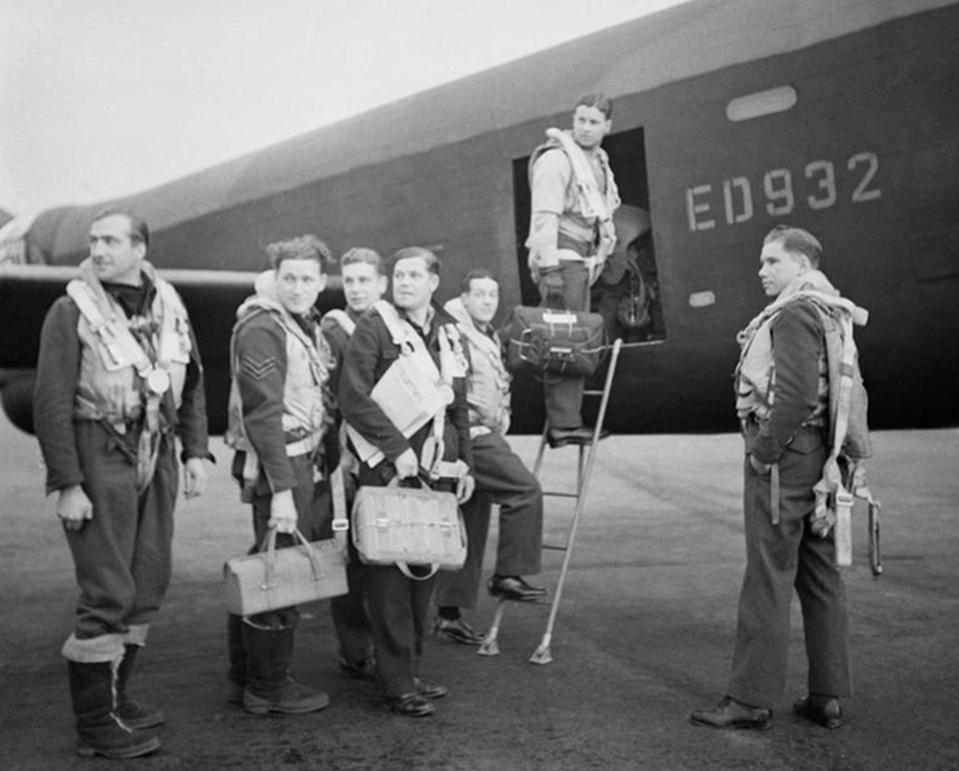 Undated handout photo issued by the Imperial War Museum of Wing Commander Gibson and his crew as they board their Avro Lancaster A3-G (ED 932/G) for the Dams' raid,  (left to right) Flight Lieutenant R D Trevor-Roper DEM; Sergeant J Pulford; Flight Sergeant G A Deering RCAF; Pilot Officer F M Spafford DFM RAAF; Flight Lieutenant R E G Hutchinson DFC; Wing Commander Guy Gibson; Pilot Officer H T Taerum RCAF, as British pilots from the Royal Navy and RAF who will form a new 617 Squadron, are training alongside the US Marine Corps on the F35B Lightning II jet at MCAS Beaufort, South Carolina, USA ahead of the aircraft entering service from 2018. PRESS ASSOCIATION Photo. Issue date: Monday May 16, 2016. The new 617 Squadron will be a combined team of Royal Navy and RAF personnel who will fly from both land and sea, based from RAF Marham and deployed periodically on the Queen Elizabeth Class Carriers. They will return to the UK in 2018 from their current training base of United States Marine Corps Air Station Beaufort in South Carolina, USA. See PA story DEFENCE Dambusters. Photo credit should read: Imperial War Museum/Richard Bayford/PA Wire  NOTE TO EDITORS: This handout photo may only be used in for editorial reporting purposes for the contemporaneous illustration of events, things or the people in the image or facts mentioned in the caption. Reuse of the picture may require further permission from the copyright holder.