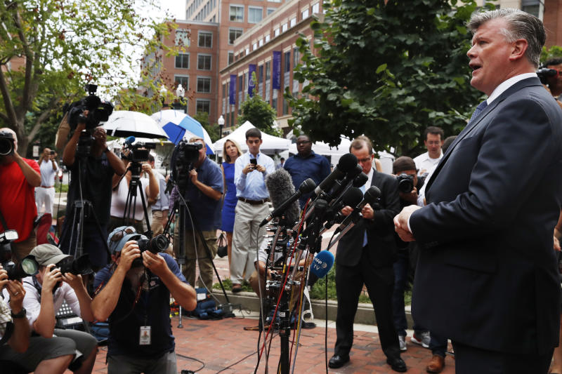 Kevin Downing, with the defense team for Paul Manafort, speaks briefly to the media on leaving federal court after jury deliberation finished for the day in the trial of the former Donald Trump campaign chairman, in Alexandria, Va., Friday, Aug. 17, 2018. (AP Photo/Jacquelyn Martin)