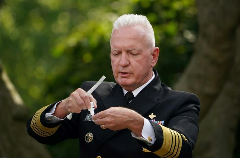 Admiral Brett Giroir, who heads the US coronavirus testing program, has called new vaccines 'the light at the end of the tunnel'