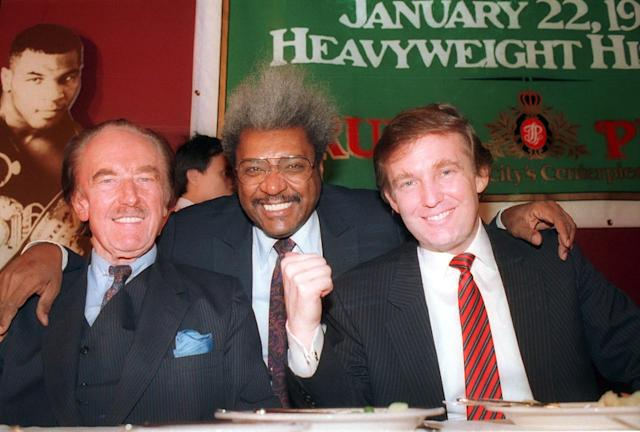 <p>Trump pictured with his father, Fred Trump and boxing promoter Don King at a press conference in December 1987 in Atlantic City, N.J. <i>(Photo: AP)</i> </p>