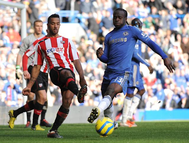 "Chelsea's Victor Moses (R) vies with Brentford's Tom Adeyemi during the fourth round replay English FA Cup football match between Chelsea and Brentford at Stamford Bridge in London on February 17, 2013. Chelsea won 4-0. AFP PHOTO/OLLY GREENWOOD - RESTRICTED TO EDITORIAL USE. No use with unauthorized audio, video, data, fixture lists, club/league logos or ""live"" services. Online in-match use limited to 45 images, no video emulation. No use in betting, games or single club/league/player publications.OLLY GREENWOOD/AFP/Getty Images"