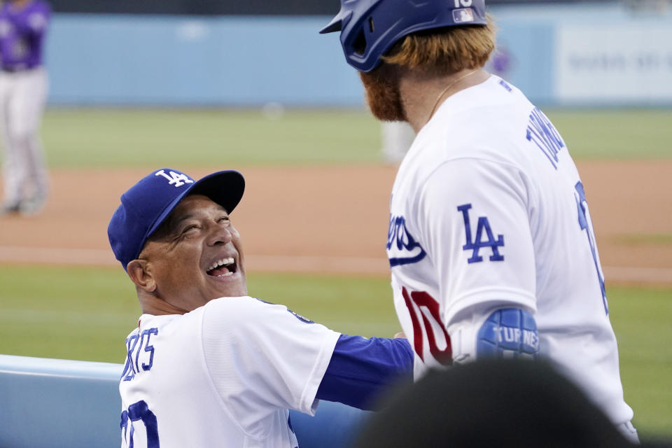 Los Angeles Dodgers' Justin Turner, right, jokes with manager Dave Roberts prior to a baseball game against the Colorado Rockies Friday, July 23, 2021, in Los Angeles. (AP Photo/Mark J. Terrill)