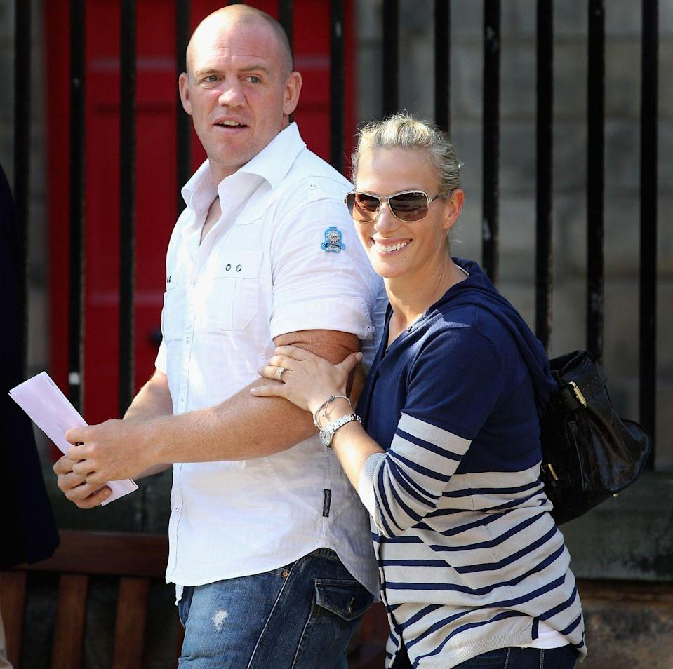 """<p><a href=""""https://www.townandcountrymag.com/society/tradition/a20150347/zara-tindall-facts/"""" rel=""""nofollow noopener"""" target=""""_blank"""" data-ylk=""""slk:The Queen's granddaughter Zara Phillips"""" class=""""link rapid-noclick-resp"""">The Queen's granddaughter Zara Phillips</a>, pictured with her then-fiancé (now husband) Mike Tindall, chose a relaxed striped cardigan for a wedding rehearsal in Edinburgh, Scotland.<br></p>"""