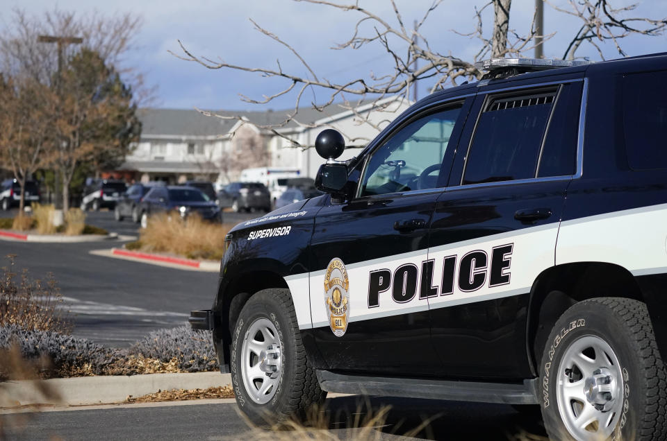 A police cruiser blocks access to the Legacy Assisted Living at Lafayette care facility, Wednesday, Feb. 3, 2021, in Lafayette, Colo. A 95-year-old resident of the assisted care home was taken into police custody Wednesday after allegedly shooting an employee at the center. (AP Photo/David Zalubowski)