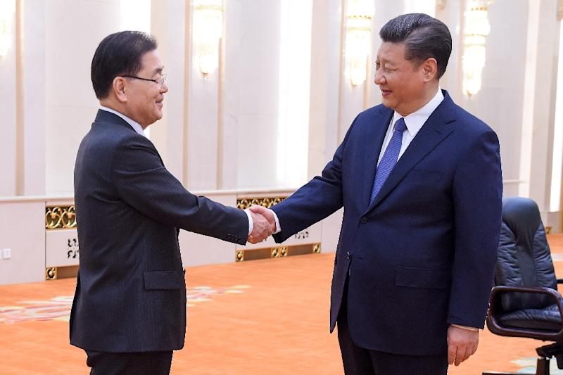 Chinese President Xi Jinping, right, met  South Korea's national security advisor Chung Eui-yong in Beijing on Monday