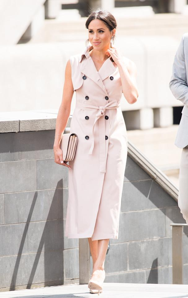 """<p>A belted trench-coat dress is one of Meghan's go-to looks. In July 2018, the duchess wore <a href=""""https://www.popsugar.com/fashion/Meghan-Markle-Pink-Trench-Dress-House-Nonie-45055695"""" class=""""ga-track"""" data-ga-category=""""Related"""" data-ga-label=""""https://www.popsugar.com/fashion/Meghan-Markle-Pink-Trench-Dress-House-Nonie-45055695"""" data-ga-action=""""In-Line Links"""">a pink trench dress by Canadian designer Nonie</a> to visit The Nelson Mandela Centenary Exhibition at Southbank Centre in July 2018.</p>"""
