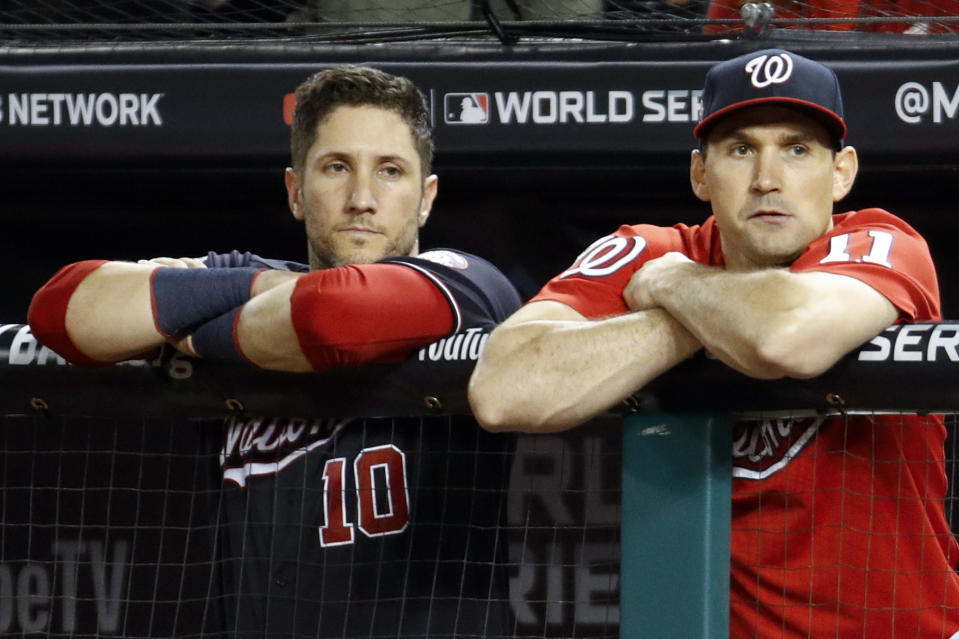 Washington Nationals catcher Yan Gomes, left, and first baseman Ryan Zimmerman watch during the ninth inning of Game 5 of the baseball World Series against the Houston Astros Sunday, Oct. 27, 2019, in Washington. (AP Photo/Patrick Semansky)