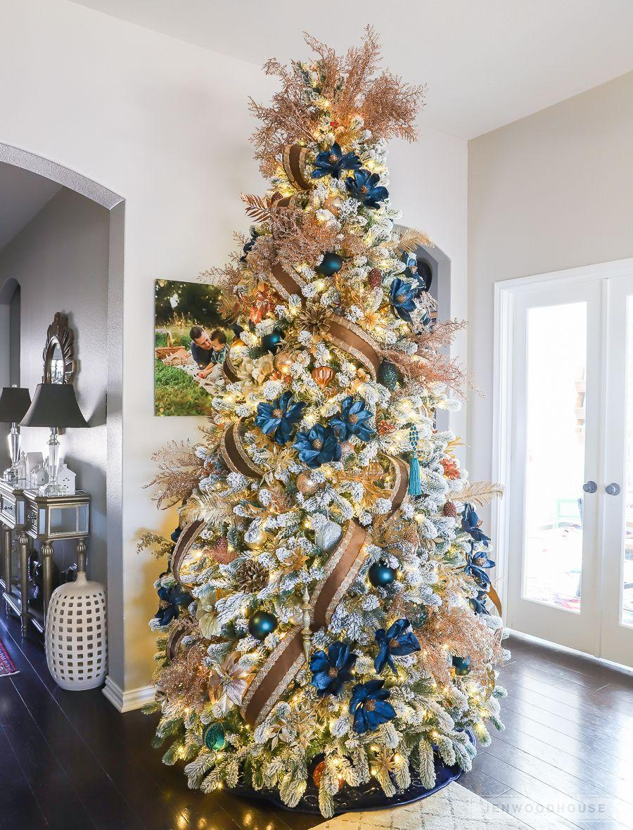 "<p>This showstopping tree designed by <a href=""https://jenwoodhouse.com/christmas-2018-home-tour/"" rel=""nofollow noopener"" target=""_blank"" data-ylk=""slk:Jen Woodhouse"" class=""link rapid-noclick-resp"">Jen Woodhouse</a> features a palette of navy blue, copper, and gold and is so packed with decor that you'll wonder if there's even a tree beneath it all. </p>"