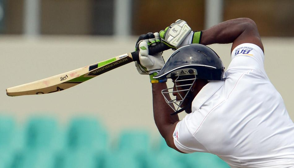 England Ashes Test cricketer Michael Carberry plays a shot during the match against a Cricket Australia Invitational XI at the Sydney Cricket Ground on November 16, 2013. (GREG WOOD/AFP/Getty Images)