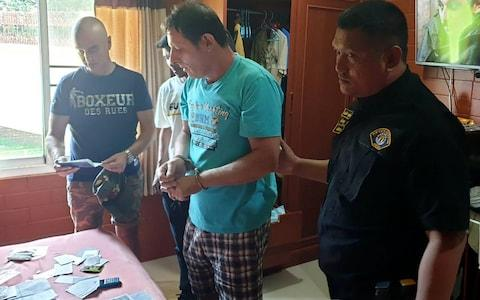 Francesco Galdelli (C) as he was arrested on the outskirts of Pattaya. - Credit: AFP