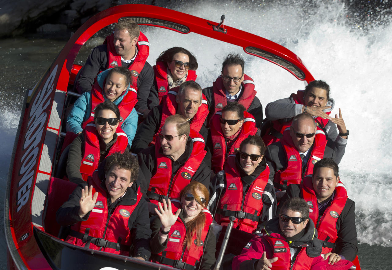 Britain's Prince William, center left, and his wife Kate, Duchess of Cambridge, center right, take a ride on the Shotover Jet boat near Queenstown, New Zealand, Sunday, April 13, 2014. The royal couple are on an official visit to New Zealand. (AP Photo/Mark Mitchell, Pool)