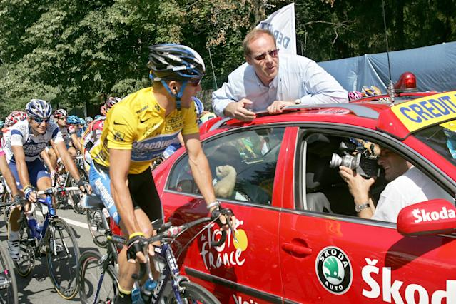 """FILE - In this July 20, 2005, file photo, overall leader Lance Armstrong, left, of Austin, Texas, talks with Tour de France vice director general Christian Prudhomme, of France, before Prudhomme gave the official start for the 17th stage of the Tour de France cycling race between Pau and Revel, southwestern France. Admitting he cheated was a start. Now, it's all about whether Armstrong is ready to give details, lots of them, to clean up his sport. """"We're left wanting more. We have to know more about the system,"""" Prudhomme told the AP. """"He couldn't have done it alone. We have to know who in his entourage helped him to do this.""""(AP Photo/Christophe Ena, File)"""