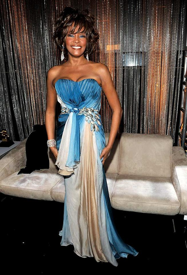 "Bad: Whitney Houston looked more like a cruise ship performer than a Grammy winner in this strapless blue-and-white gown and matronly 'do. Kevin Mazur/<a href=""http://www.wireimage.com"" target=""new"">WireImage.com</a> - February 8, 2009"