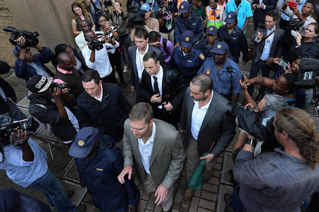 PRETORIA, SOUTH AFRICA - MARCH 05: Oscar Pistorius leaves North Gauteng High Court at the end of the third day of his trial accused of the murder of his girlfriend Reeva Steenkamp on March 5, 2014 in Pretoria, South Africa. Olympic and Paralympic athlete Oscar Pistorius, aged 27, is accused of murdering his girlfriend Reeva Steenkamp. Pistorius denies the allegation claiming he mistook Steenkamp for an intruder inside their home on Valentines Day 2013. (Photo by Christopher Furlong/Getty Images)