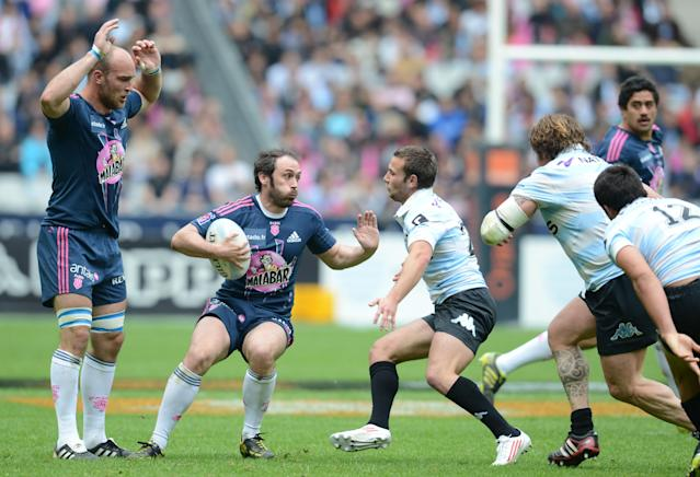 Stade Français' scrum-half Julien Dupuy (C) runs with the ball during the French Top 14 rugby union match Stade Francais vs. Racing Metro on May 5, 2012 at the Stade de France stadium in Saint-Denis. AFP PHOTO / FRANCK FIFEFRANCK FIFE/AFP/GettyImages