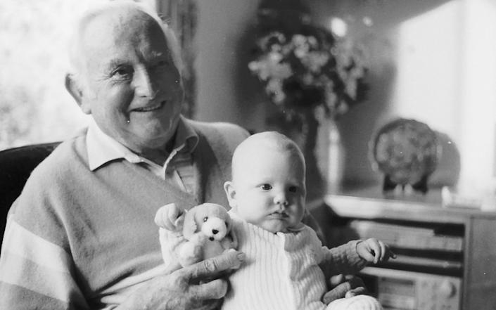 Michael's father Eric Dobbs with his grandson Will – Michael says 'it was that silence that killed my father' - Jay Williams for The Telegraph