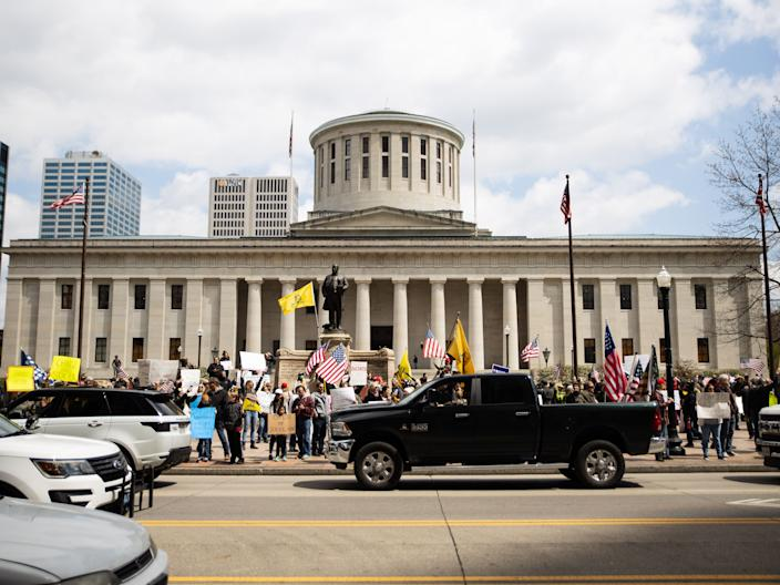 Protesters rally at the Ohio State House in Columbus, Ohio on April 18, 2020, to protest the stay home order that is in effect until May 1st.