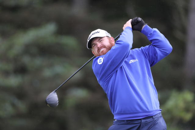 J.B. Holmes of the United States plays tee shot on the 5th hole during the first round of the British Open Golf Championships at Royal Portrush in Northern Ireland, Thursday, July 18, 2019. (AP Photo/Str)