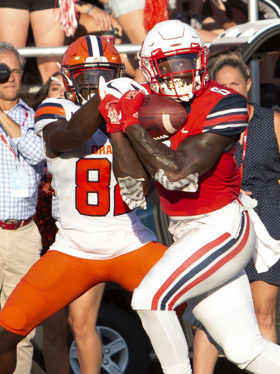 Liberty University safety Ceneca Espinoza, Jr. intercepts the ball that was intended for Syracuse wide receiver Nykeim Johnson during an NCAA college football game in Lynchburg, Va. Saturday, Aug. 31, 2019. (AP Photo/Matt Bell)
