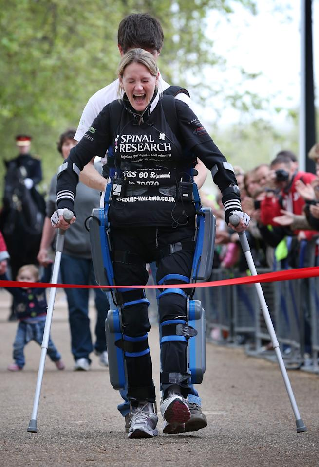 LONDON, ENGLAND - MAY 08:  Claire Lomas crosses the finishing line of the Virgin London Marathon on May 8, 2012 in London, England. Ms Lomas, who is paralysed from the waist down after a riding accident in 2007, has taken 16 days to complete the 26.2 mile route. Starting out with 36,000 other runners she has averaged 2 miles a day with the help of a bionic ReWalk suit.  (Photo by Peter Macdiarmid/Getty Images)