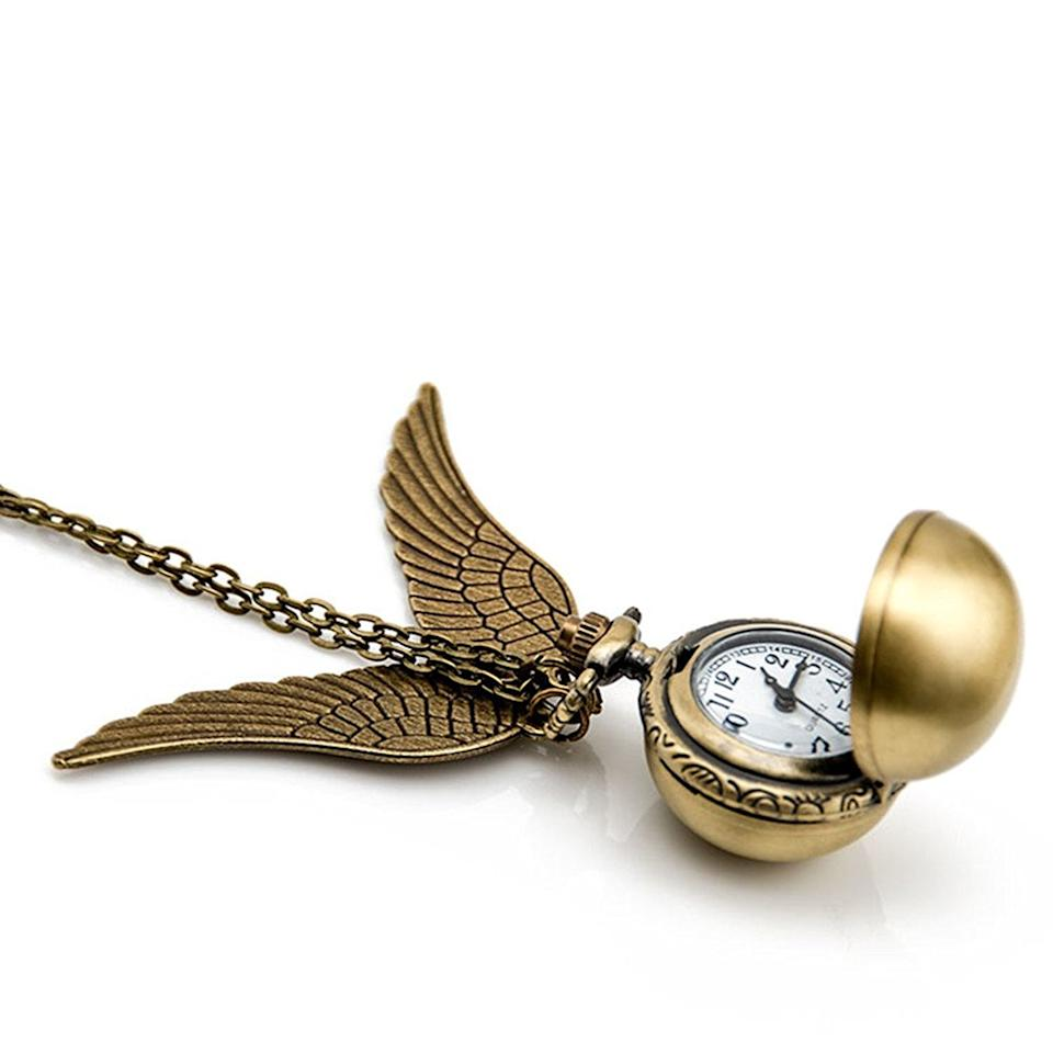 "<p>You can easily incorporate this <a href=""https://www.popsugar.com/buy/Golden-Snitch-Necklace-109364?p_name=Golden%20Snitch%20Necklace&retailer=amazon.com&pid=109364&price=8&evar1=moms%3Aus&evar9=44308327&evar98=https%3A%2F%2Fwww.popsugar.com%2Fphoto-gallery%2F44308327%2Fimage%2F44308366%2FGolden-Snitch-Necklace&list1=amazon%2Choliday%2Cstocking%20stuffers%2Cchristmas%2Cgift%20guide%2Charry%20potter%2Cgifts%20under%20%2425%2Cgifts%20for%20women%2Cgifts%20for%20men%2Cgifts%20under%20%24100%2Cgifts%20under%20%2450%2Cgifts%20under%20%2475%2Cgifts%20for%20teens%2Ctrending%20gifts&prop13=api&pdata=1"" rel=""nofollow"" data-shoppable-link=""1"" target=""_blank"" class=""ga-track"" data-ga-category=""Related"" data-ga-label=""https://www.amazon.com/Flying-necklace-Vintage-Necklace-Steampunk/dp/B01JJANU62/ref=sr_1_4?s=apparel&amp;ie=UTF8&amp;qid=1511906711&amp;sr=1-4&amp;nodeID=7141123011&amp;psd=1&amp;keywords=harry+potter+merchandise&amp;refinements=p_36%3A-2200"" data-ga-action=""In-Line Links"">Golden Snitch Necklace</a> ($8) into an outfit.</p>"