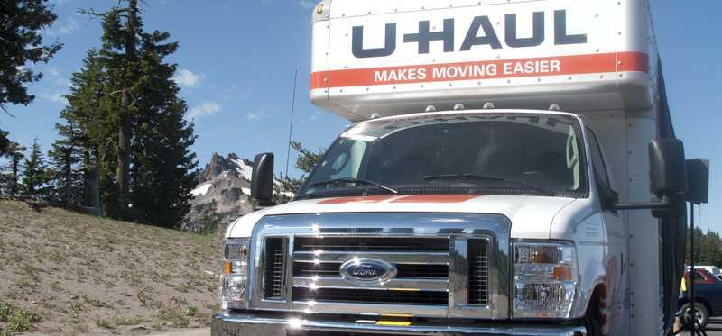 A U-Haul truck on the road.