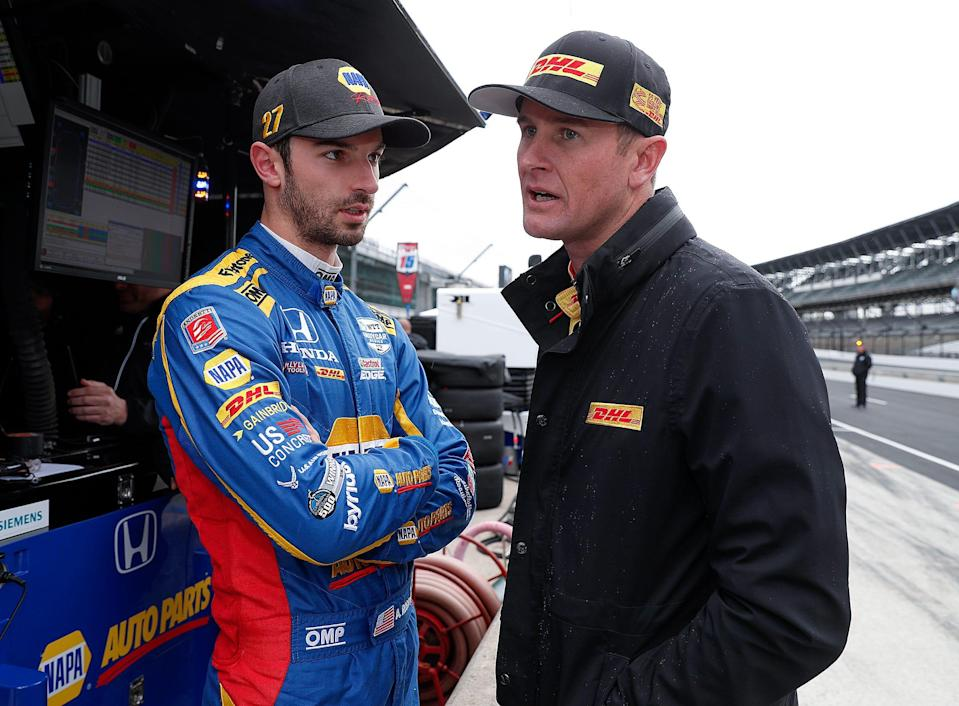 Andretti Autosport drivers Alexander Rossi, left, and Ryan Hunter-Reay talk in their pit box during testing for the 2019 Indianapolis 500.