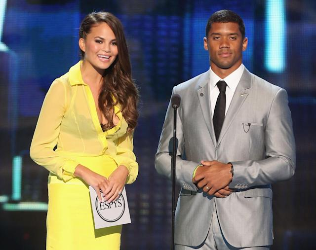 LOS ANGELES, CA - JULY 17: (R-L) NFL player Russell Wilson and model Chrissy Teigen present award for best game onstage at The 2013 ESPY Awards at Nokia Theatre L.A. Live on July 17, 2013 in Los Angeles, California. (Photo by Frederick M. Brown/Getty Images for ESPY)