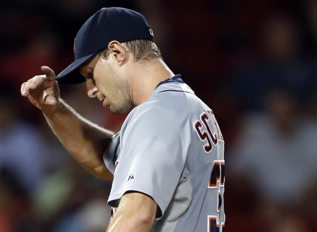 Detroit Tigers starting pitcher Max Scherzer reacts during the fifth inning of a baseball game against the Boston Red Sox at Fenway Park in Boston, Tuesday, Sept. 3, 2013. (AP Photo/Elise Amendola)