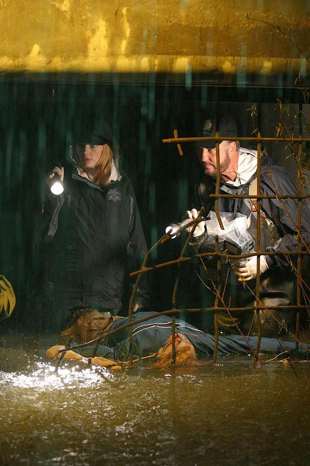 "Catherine and Grissom search a tunnel to investigate the apparent murder of a lifeguard who was discovered in a storm drain following a heavy rain. (""Down the Drain"" 10/7/2004, Season 5)"