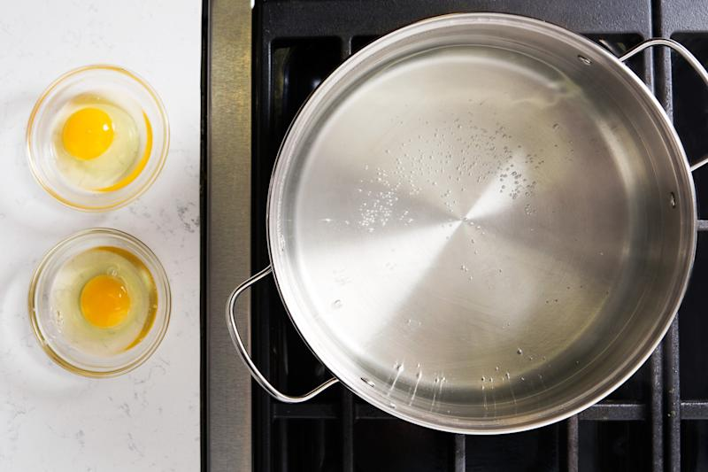 Some people swear that to get perfect poached eggs, you need to add vinegar to the water. Don't listen to them. What's important is using fresh eggs—they hold their shape better than older ones. The water temperature is also key: You aren't looking for a rolling boil or even a simmer here. (All that motion will shake and possibly break your egg.) Instead, heat a large pot of salted water over high until you start to see tiny bubbles appear on the bottom (the temperature should be around 180°F). Reduce heat to very low to keep it there, or, if you need to, remove the pot from the heat altogether.