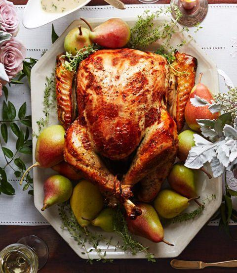 """<p>Brine your bird with pear nectar, fresh herbs and spices for this year's feast. The sugars from the pears help create that golden-brown sheen.</p><p><em><a href=""""https://www.womansday.com/food-recipes/food-drinks/recipes/a39948/pear-thyme-turkey-recipe-clx1114/"""" rel=""""nofollow noopener"""" target=""""_blank"""" data-ylk=""""slk:Get the recipe from Woman's Day »"""" class=""""link rapid-noclick-resp"""">Get the recipe from Woman's Day »</a></em></p><p><strong>RELATED: </strong><a href=""""https://www.goodhousekeeping.com/holidays/thanksgiving-ideas/g4689/thanksgiving-turkey-recipes/"""" rel=""""nofollow noopener"""" target=""""_blank"""" data-ylk=""""slk:18 Turkey Recipes That Will Wow Your Guests This Thanksgiving"""" class=""""link rapid-noclick-resp"""">18 Turkey Recipes That Will Wow Your Guests This Thanksgiving</a><br></p>"""