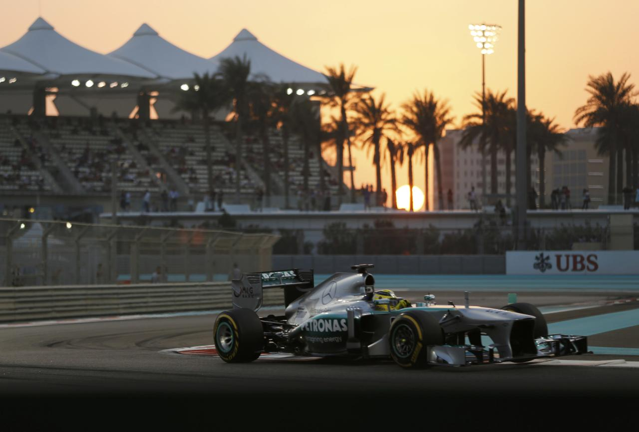 Mercedes Formula One driver Nico Rosberg of Germany takes a corner during the qualifying session of the Abu Dhabi F1 Grand Prix at the Yas Marina circuit on Yas Island, November 2, 2013. REUTERS/Ahmed Jadallah (UNITED ARAB EMIRATES - Tags: SPORT MOTORSPORT F1)
