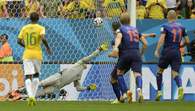 Netherlands' Robin van Persie, third right, scores the opening goal from the penalty spot during the World Cup third-place soccer match between Brazil and the Netherlands at the Estadio Nacional in Brasilia, Brazil, Saturday, July 12, 2014. (AP Photo/Manu Fernandez)
