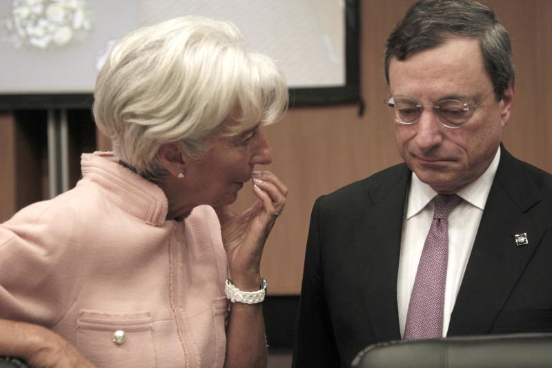 President of the European Central Bank Mario Draghi, left, talks with the Managing Director of the IMF Christine Lagarde, prior of the Informal European economic and financial affairs council in capital Nicosia, Cyprus, Friday, Sept. 14, 2012. European finance ministers are gathering in Cyprus for two days of discussions about the debt crisis and the latest developments in Greece and Spain. (AP Photo/Dimitri Messinis)