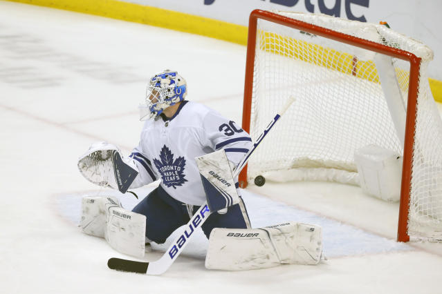 A shot by Florida Panthers center Vincent Trocheck gets past Toronto Maple Leafs goaltender Michael Hutchinson (30) for a goal during the second period of an NHL hockey game, Sunday, Jan. 12, 2020, in Sunrise, Fla. (AP Photo/Wilfredo Lee)