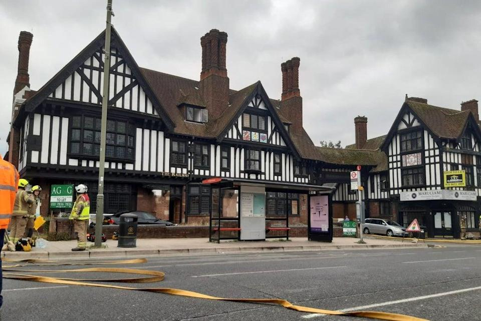 Firefighters dampen down the Railway Tavern  (LFB)
