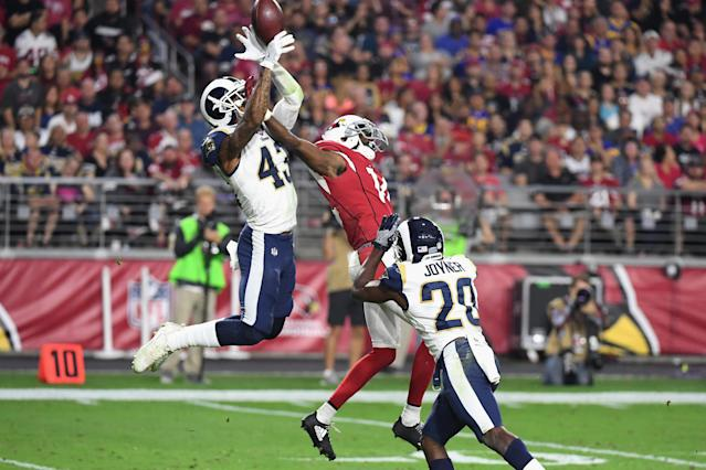 <p>Strong safety John Johnson #43 and free safety Lamarcus Joyner #20 of the Los Angeles Rams break up a pass intended for wide receiver J.J. Nelson #14 of the Arizona Cardinals during the second half of the NFL game at the University of Phoenix Stadium on December 3, 2017 in Glendale, Arizona. (Photo by Norm Hall/Getty Images) </p>