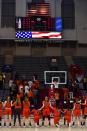 Sydney Jordan #20, Qalea Ismail #23 and Kenya Holland #24 of the Princeton Tigers kneel during the national anthem before the game at The Palestra on March 11, 2018 in Philadelphia, Pennsylvania. Princeton defeated Penn 63-34 for the Women's Ivy League Tournament Championship title. (Photo by Corey Perrine/Getty Images)