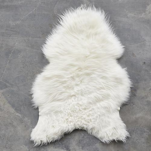 """<p><strong>The Organic Sheep</strong></p><p>rwguild.com</p><p><strong>$275.00</strong></p><p><a href=""""https://rwguild.com/collections/soft-goods/products/the-organic-sheep-sheepskin-longhair?variant=31945374728295"""" rel=""""nofollow noopener"""" target=""""_blank"""" data-ylk=""""slk:Get the Look"""" class=""""link rapid-noclick-resp"""">Get the Look</a></p><p>This cozy piece was ethically and environmentally sourced so you can feel extra-excited about your purchase. It's perfect for creating a layered look or displaying as is. </p>"""