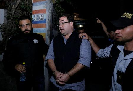 Former governor of Mexican state Veracruz Javier Duarte is escorted by authorities after he was detained in a hotel in Panajachel