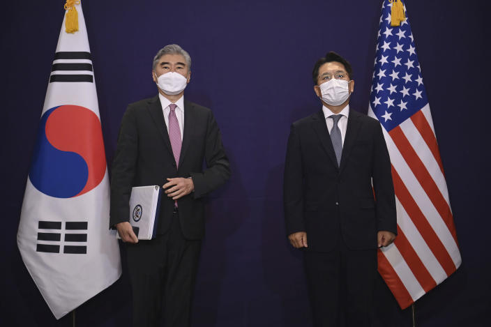 U.S. special representative for North Korea Sung Kim, left, and South Korea's Special Representative for Korean Peninsula Peace and Security Affairs Noh Kyu-duk pose for a photo during their bilateral meeting at a hotel in Seoul Monday, June 21, 2021. (Jung Yeon-je/Pool Photo via AP)