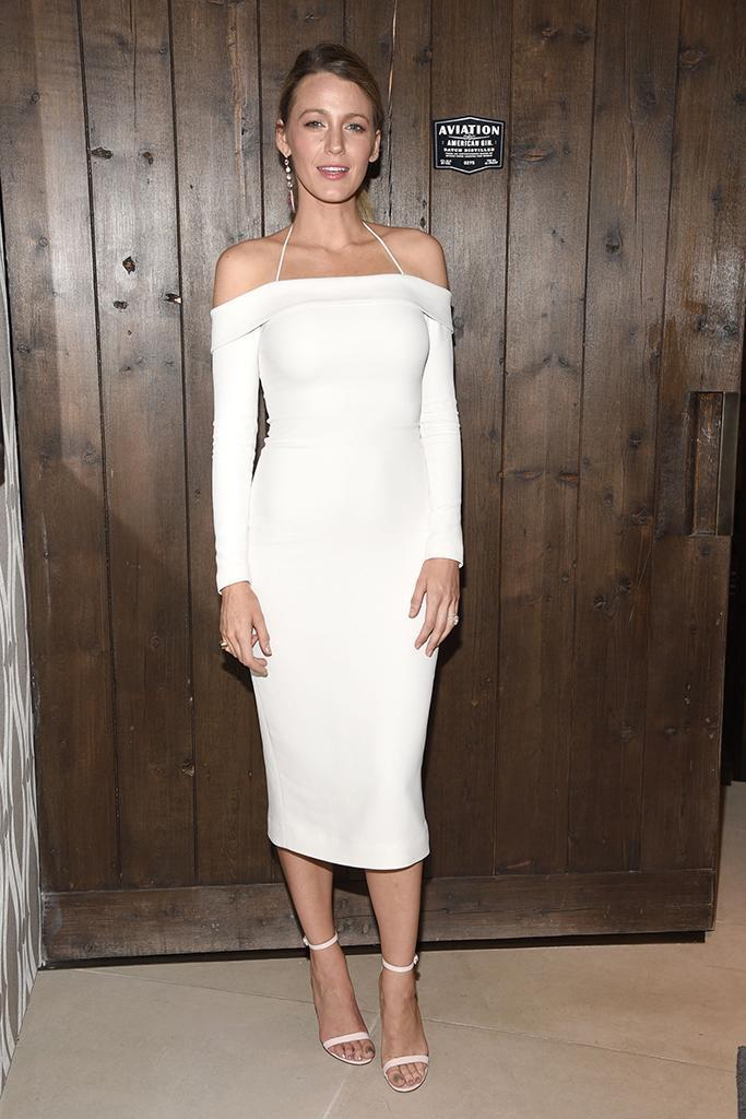 Blake Lively paired her midi dress with strappy heels and a drop earring. (Photo: Michael Simon/startraksphoto.com)