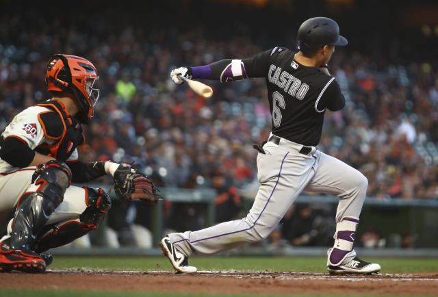 Colorado Rockies' Daniel Castro and San Francisco Giants catcher Buster Posey watch Castro's two-run double hit off Giants pitcher Jeff Samardzija during the second inning of a baseball game Thursday, May 17, 2018, in San Francisco. (AP Photo/Ben Margot)