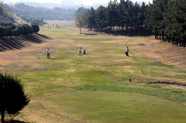 Local golfers compete during Iran's National Golf Tournament, at Engelhab sports club in Tehran (AFP Photo/Atta Kenare)