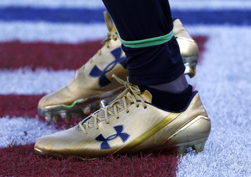 Under Armour reports 4Q loss