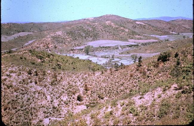 "<p class=""MsoNormal"" style=""""><span>The view down on the valleys and rice paddies surrounding ""A"" Echelon of the 1st Battalion, Princess Patricia's Canadian Light Infantry, circa 1952. Photo courtesy of <a target=""_blank"" href=""http://www.thememoryproject.com/stories/Korea/"">Ron Carruth</a> and <a target=""_blank"" href=""http://www.thememoryproject.com/"">Historica-Dominion Institute</a>.<br></span></p>"